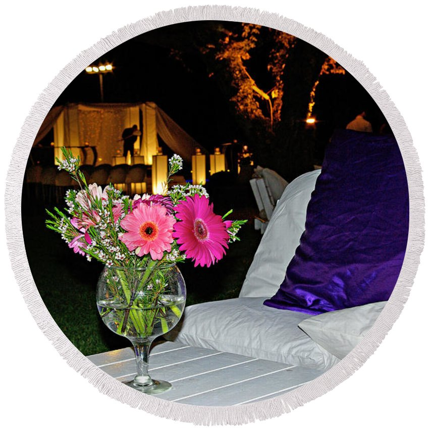 Flowers Round Beach Towel featuring the photograph Flowers In A Vase On A White Table by Zal Latzkovich