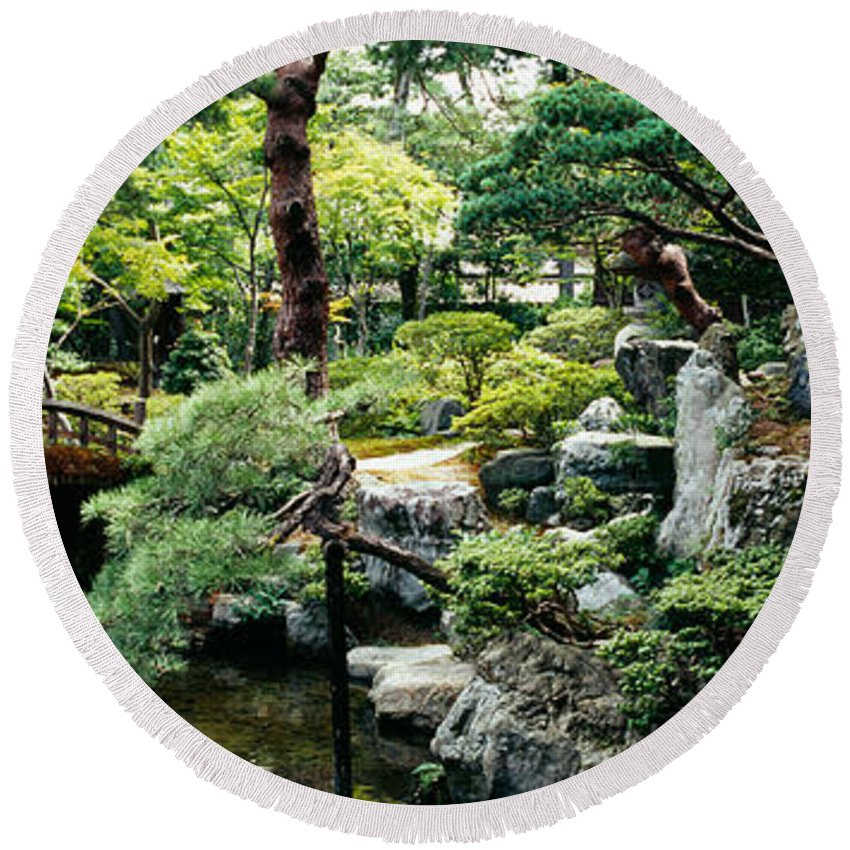 Photography Round Beach Towel featuring the photograph Footbridge Across A Pond, Kyoto by Panoramic Images