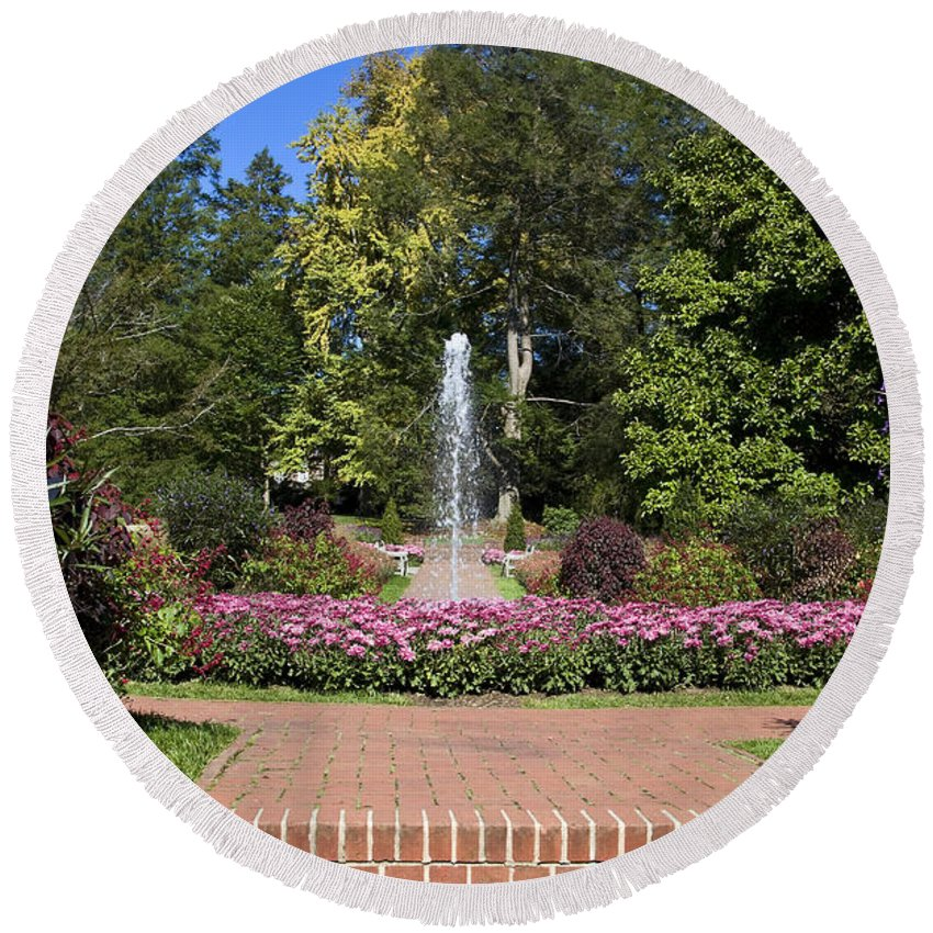 Garden Scene Round Beach Towel featuring the photograph Fountain Among Flowers by Sally Weigand