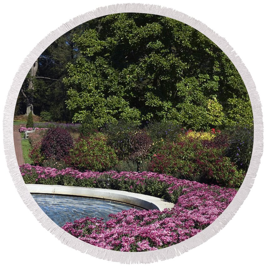 Garden Scene Round Beach Towel featuring the photograph Fountain And Mums by Sally Weigand