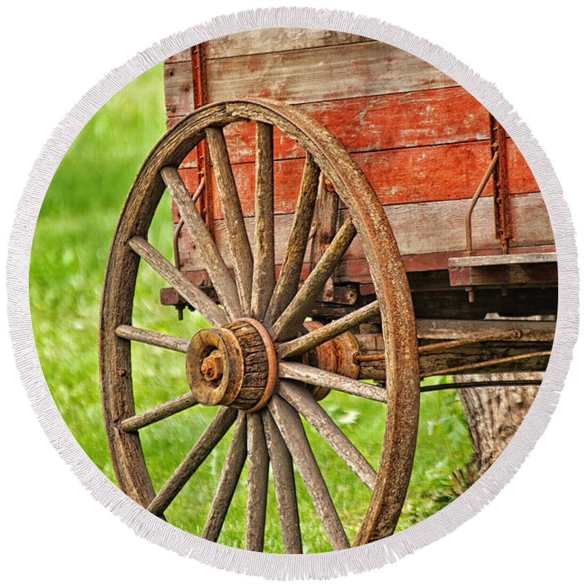 Tim Flanigan Round Beach Towel featuring the photograph Freight Wagon Wheel by Timothy Flanigan