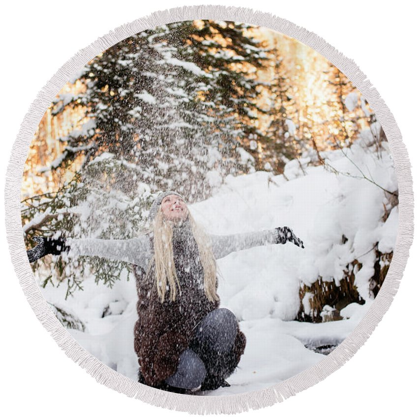 Travel Round Beach Towel featuring the photograph Girl Playing In The Snow In The Woods by Tamara Kirsanova