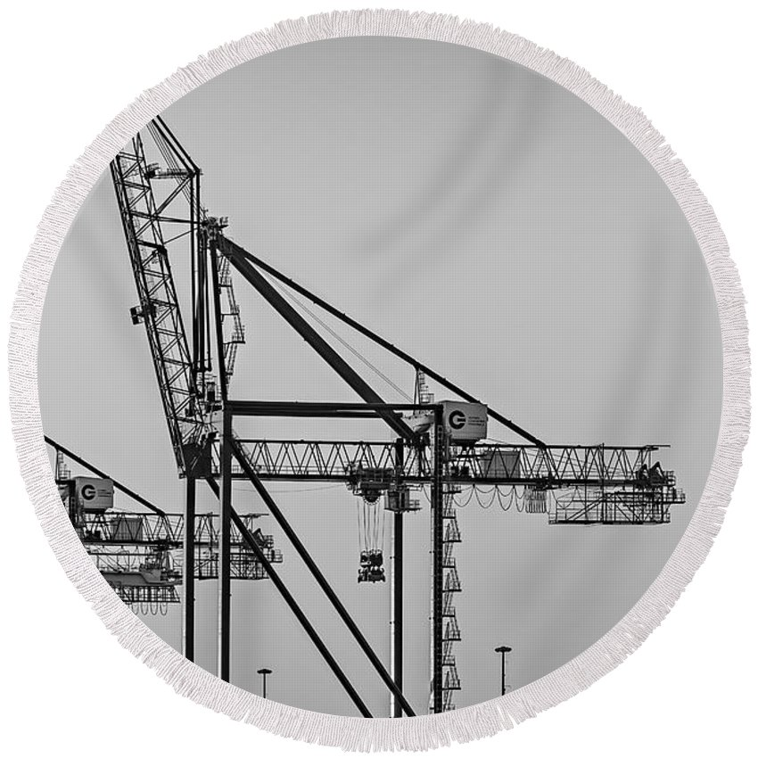 Crane Round Beach Towel featuring the photograph Global Containers Terminal Cargo Freight Cranes Bw by Susan Candelario
