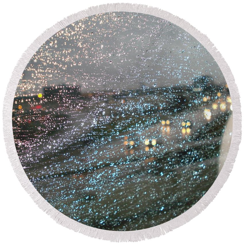 Usha Round Beach Towel featuring the photograph Glowing Raindrops In The City by Usha Shantharam
