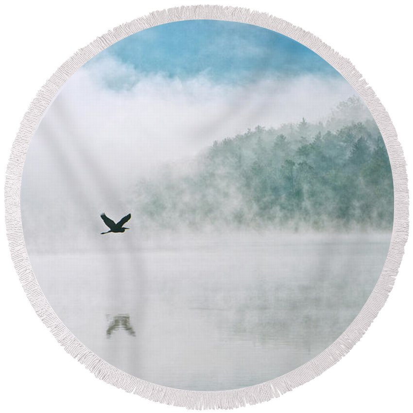 Steam Round Beach Towel featuring the photograph Great Blue Heron Flight Over Foggy Lake by Leon Winkowski