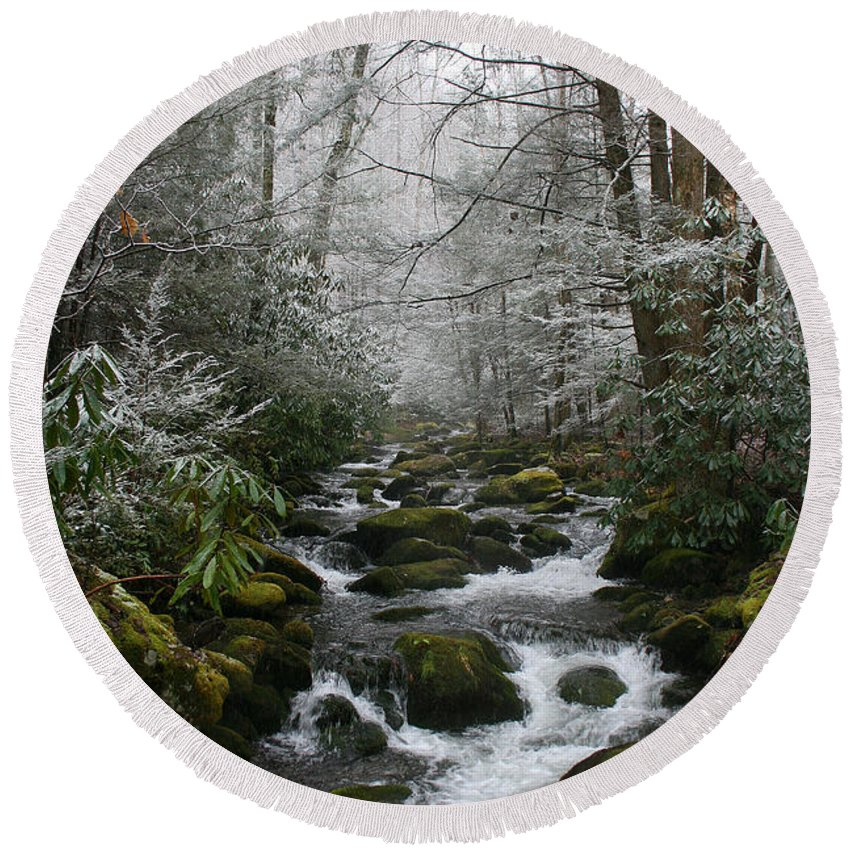 Green Snow Tree Trees Winter Stream River Creek Water Stone Rock Flow Boulder Forest Woods Cold Round Beach Towel featuring the photograph Green And White by Andrei Shliakhau