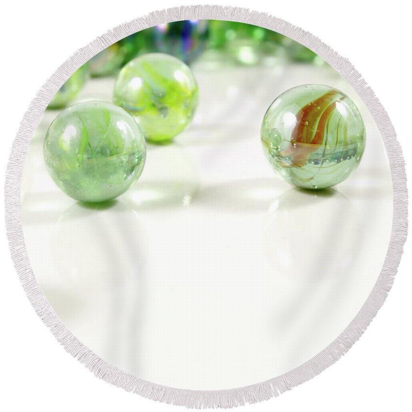 Marbles Round Beach Towel featuring the photograph Green Glass Marbles Close-up Views by Daniel Ghioldi