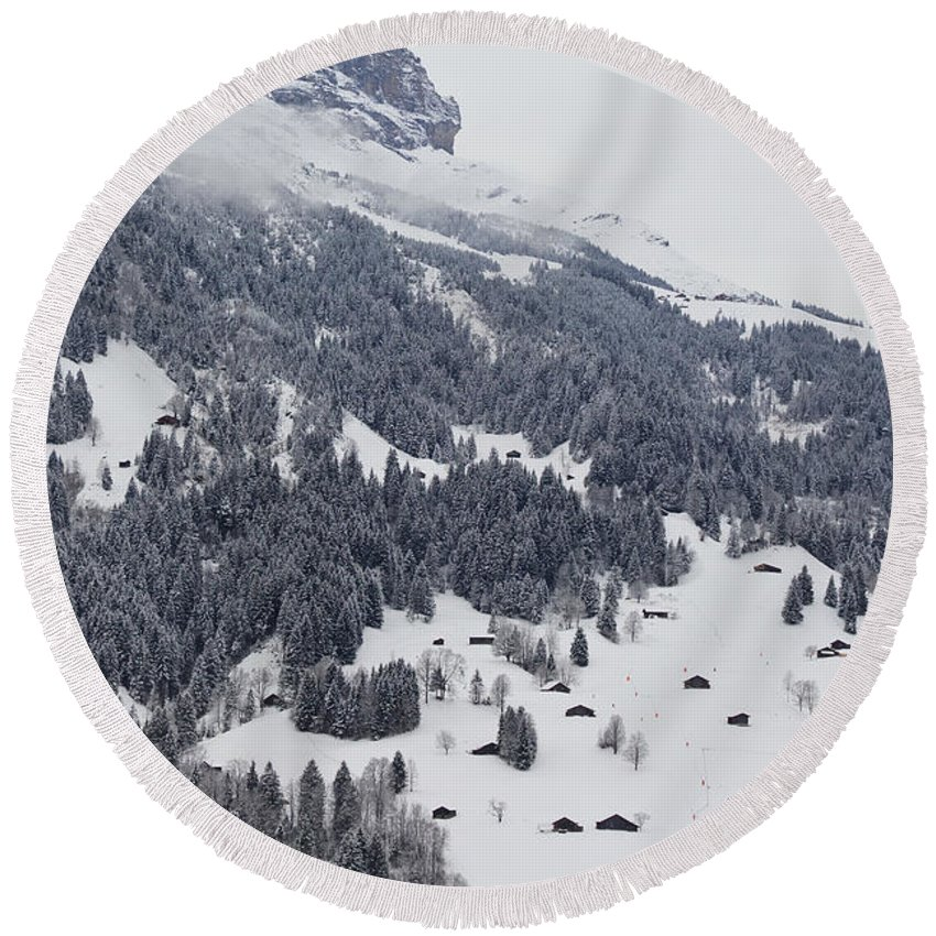 Landscape Round Beach Towel featuring the photograph Grindelwald In Winter 3 by Pavel Klyuyev