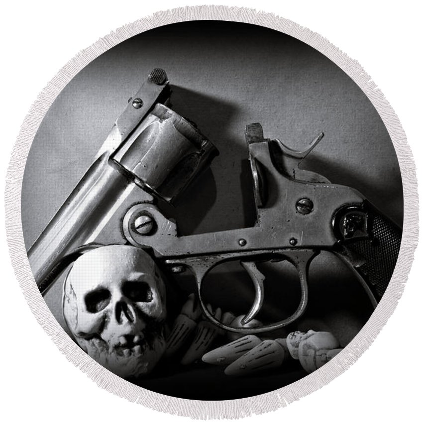 Black And White Round Beach Towel featuring the photograph Gun And Skull by Scott Wyatt