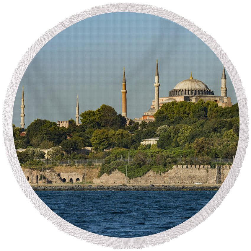 Hagia Sophia Istanbul Turkey Building Buildings Church Churches Minaret Minarets Places Place Of Worship Tree Trees Cities Cities Cityscape Structure Structures Architecture Cityscapes Landmark Landmarks Landscape Landscapes Water Waterscape Waterscapes Bosphorus Strait Sultan Ahmet Camii Blue Mosque Mosques Wall Stone Walls Dome Domes Golden Horn Round Beach Towel featuring the photograph Hagia Sophia And Blue Mosque by Bob Phillips