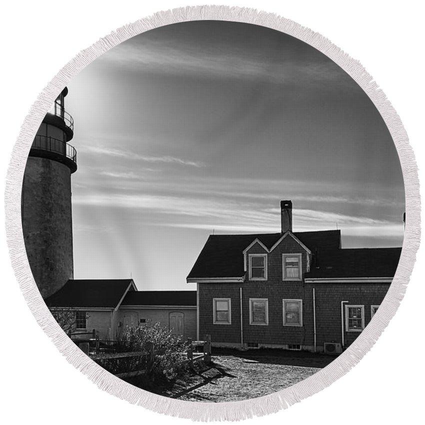 Joan Carroll Round Beach Towel featuring the photograph Highland Lighthouse Bw by Joan Carroll