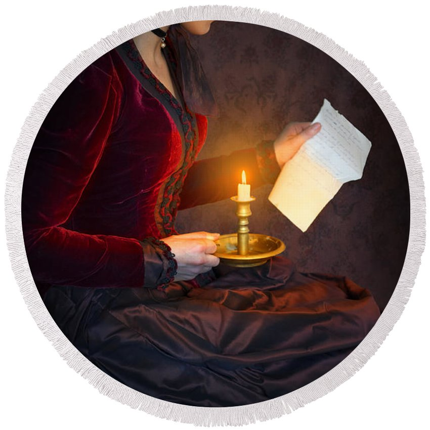 Victorian Round Beach Towel featuring the photograph Historical Victorian Woman Reading A Letter By Candlelight by Lee Avison