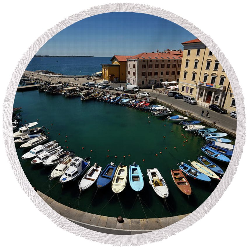 Horseshoe Round Beach Towel featuring the photograph Horseshoe Pattern Of Moored Boats At The Inner Harbour Of Piran by Reimar Gaertner