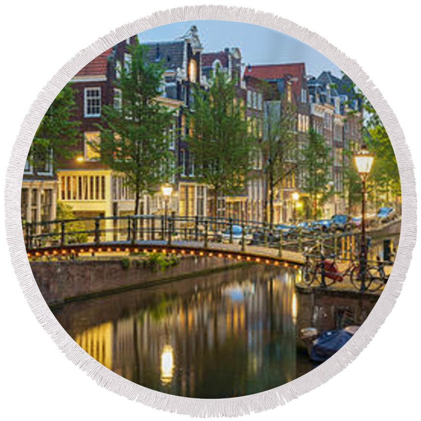 Photography Round Beach Towel featuring the photograph Houses Along Canal At Dusk by Panoramic Images