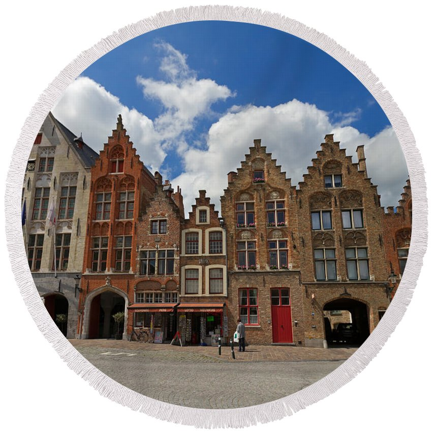Old Tollhouse Round Beach Towel featuring the photograph Houses Of Jan Van Eyck Square In Bruges Belgium by Louise Heusinkveld