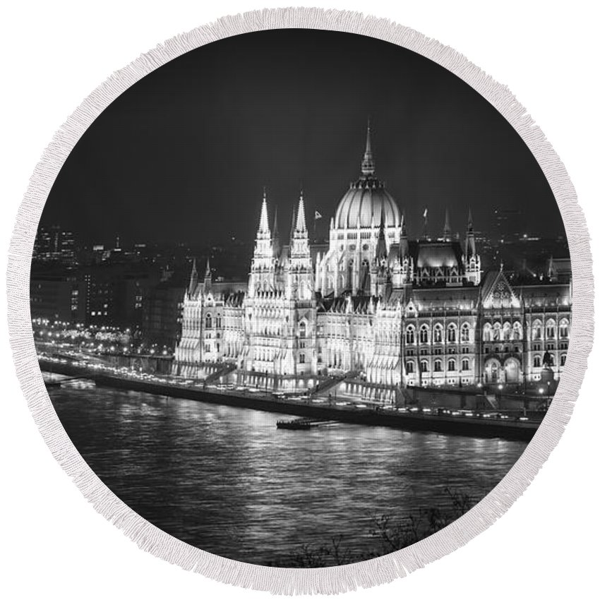 Joan Carroll Round Beach Towel featuring the photograph Hungarian Parliament Night Bw by Joan Carroll