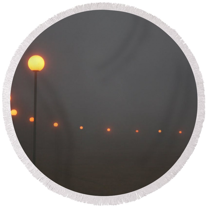 Ice Fog Park Lamps Misty Cold Weather Eerie Round Beach Towel featuring the photograph Ice Fog And Park Lamps by Andrea Lawrence