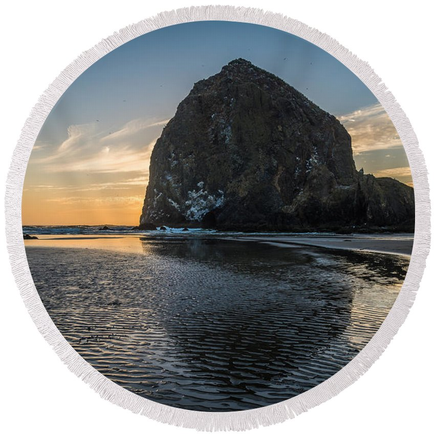 Haystack Rock Round Beach Towel featuring the photograph Immovable Object by Kristopher Schoenleber