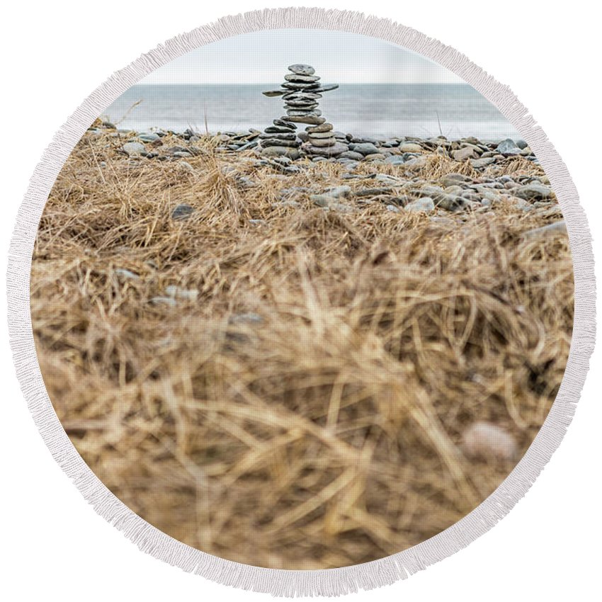 Atlantic Canada Round Beach Towel featuring the photograph Inukshuk At Lawrencetown Beach, Nova Scotia by Mike Organ
