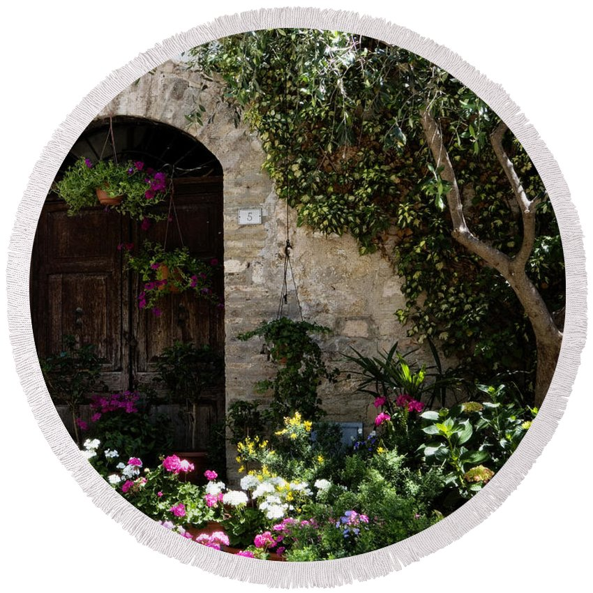 Flower Round Beach Towel featuring the photograph Italian Front Door Adorned With Flowers by Marilyn Hunt