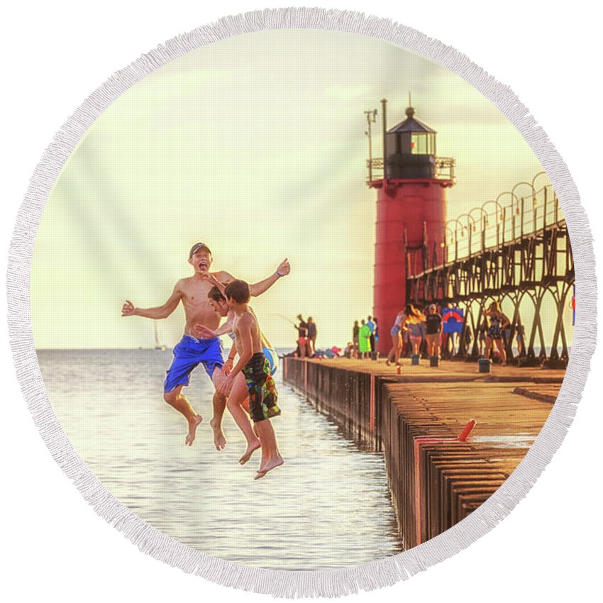 South Haven Lighthouse Round Beach Towel featuring the photograph Jump by J Thomas