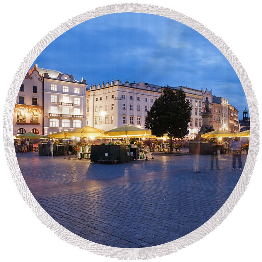 Krakow Round Beach Towel featuring the photograph Krakow Main Square By Night by Artur Bogacki