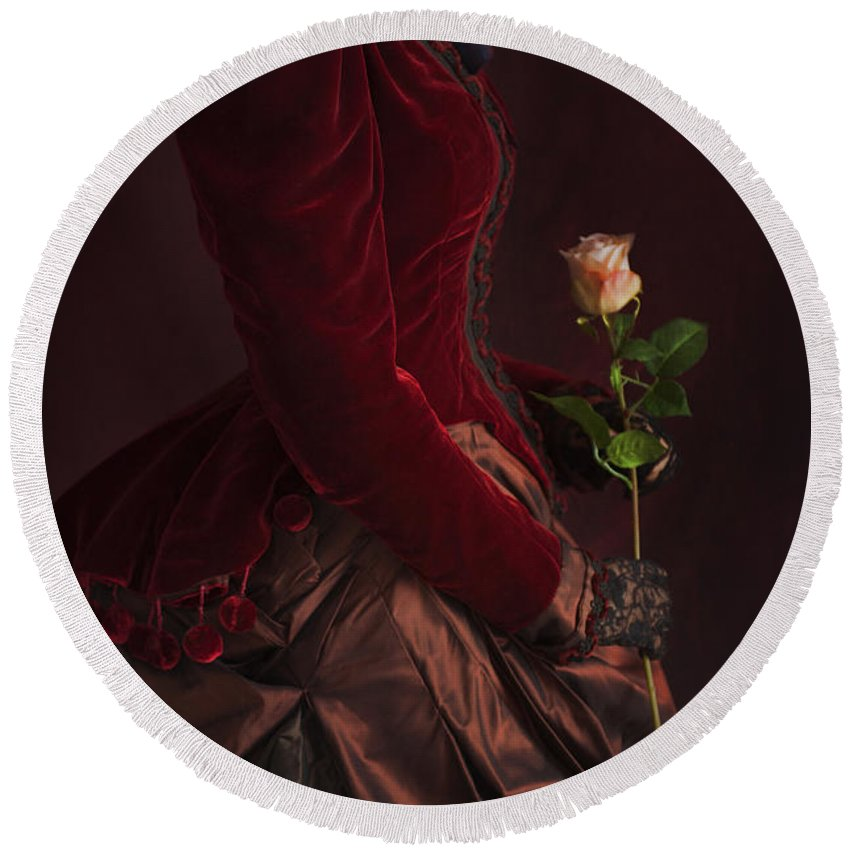 Victorian Round Beach Towel featuring the photograph Late Victorian Woman In A Crimson Velvet Jacket And Dress Holdin by Lee Avison