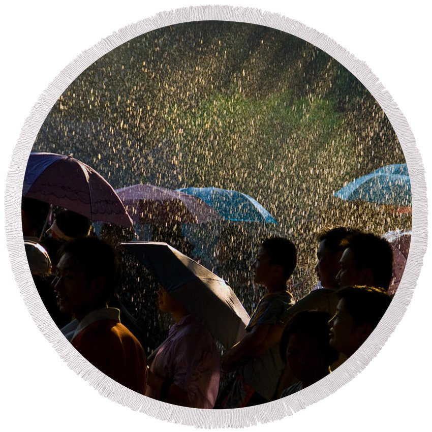 Rain Round Beach Towel featuring the photograph Laughter In The Rain by Venetta Archer