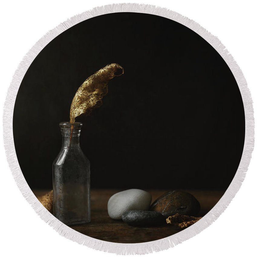 Still Life Round Beach Towel featuring the photograph Leaf Bottle Rocks by Scott Norris