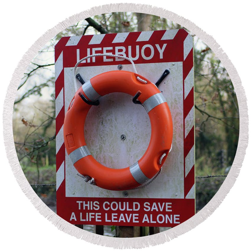 Safety Round Beach Towel featuring the photograph Lifebuoy Theft by Dave Philp
