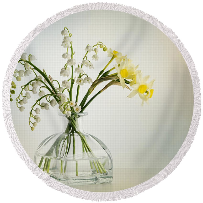 Lilies Of The Valley Round Beach Towel featuring the photograph Lilies Of The Valley In A Glass Vase by Ann Garrett