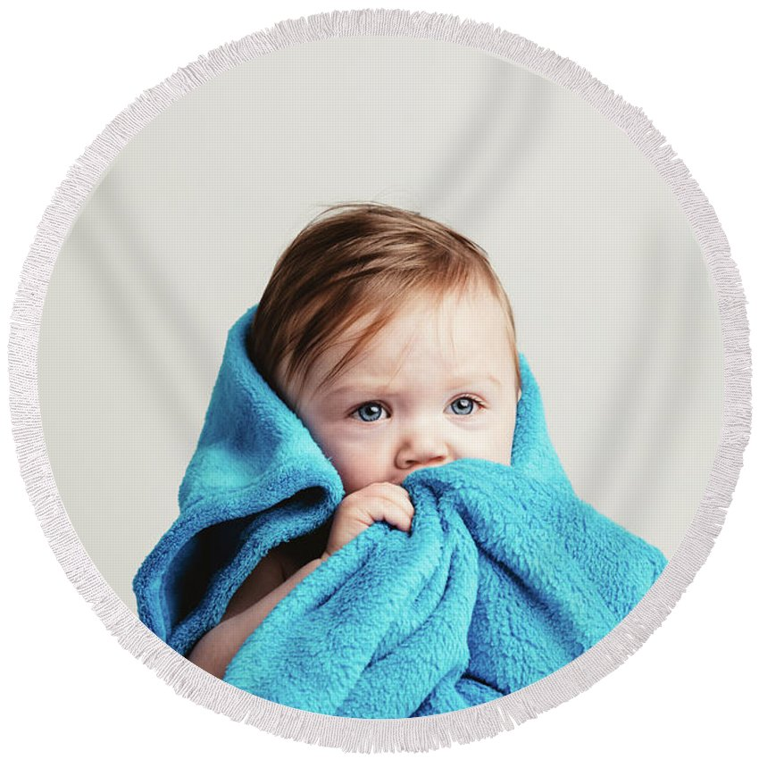 Baby Round Beach Towel featuring the photograph Little Baby Girl Tucked In A Cozy Blue Blanket. by Michal Bednarek