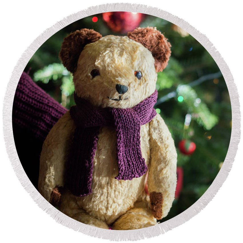 Teddy Round Beach Towel featuring the photograph Little Sweet Teddy Bear With Knitted Scarf Under The Christmas Tree by Andrea Varga