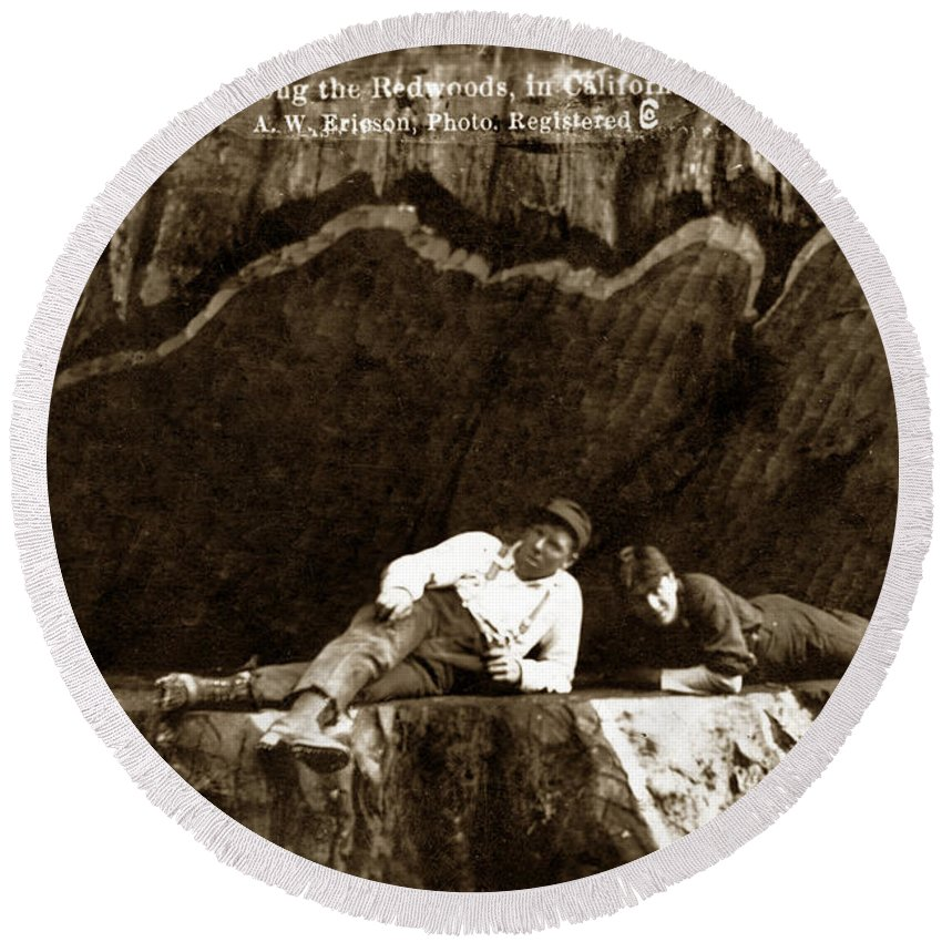 Logging Redwoods Round Beach Towel featuring the photograph Logger With Ax On Springboard Loggers Sitting Inside Undercut Circa 1890 by California Views Mr Pat Hathaway Archives