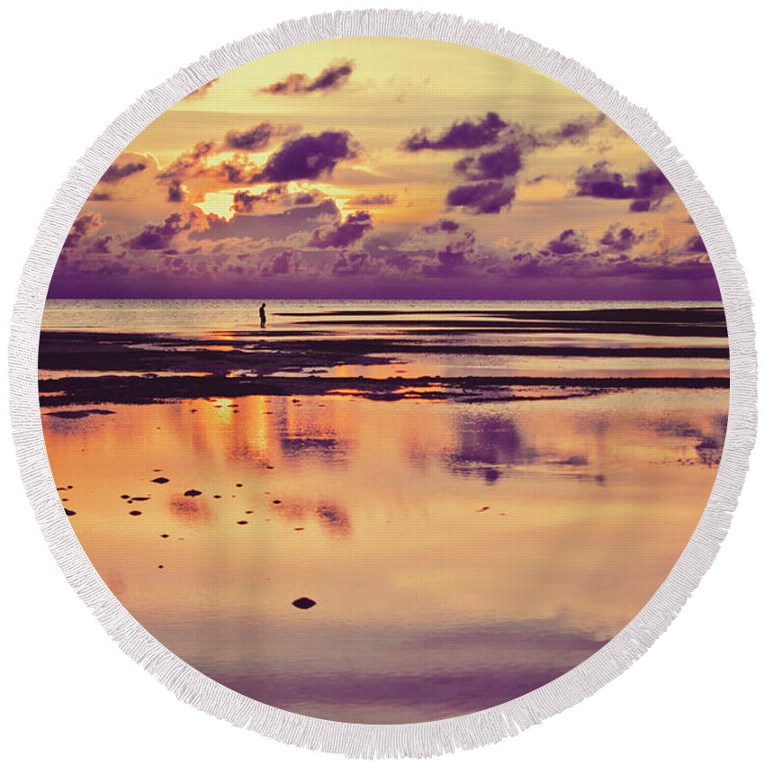 Alone Round Beach Towel featuring the pyrography Lone Fisherman In Distance During Beautiful Reflected Sunset With Dramatic Clouds In Maldives by Srdjan Kirtic
