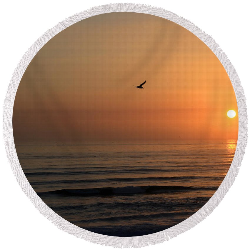Bird Fly Flight Gull Alone Sun Sunrise Sky Ocean Wave Reflection Nature Golden Gold Round Beach Towel featuring the photograph Lonely Flight by Andrei Shliakhau