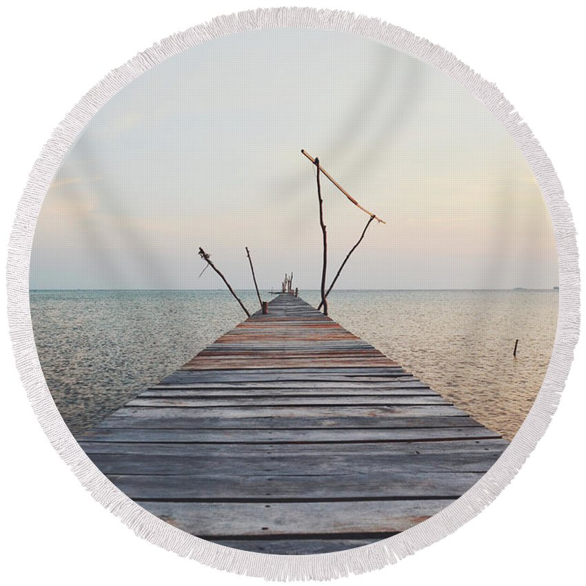 Calm Round Beach Towel featuring the photograph Long, Empty And Old Wooden Dock Over The Water At Sunset by Srdjan Kirtic