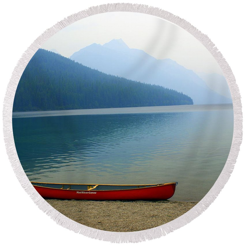 Glacier National Park Round Beach Towel featuring the photograph Lonly Canoe by Marty Koch