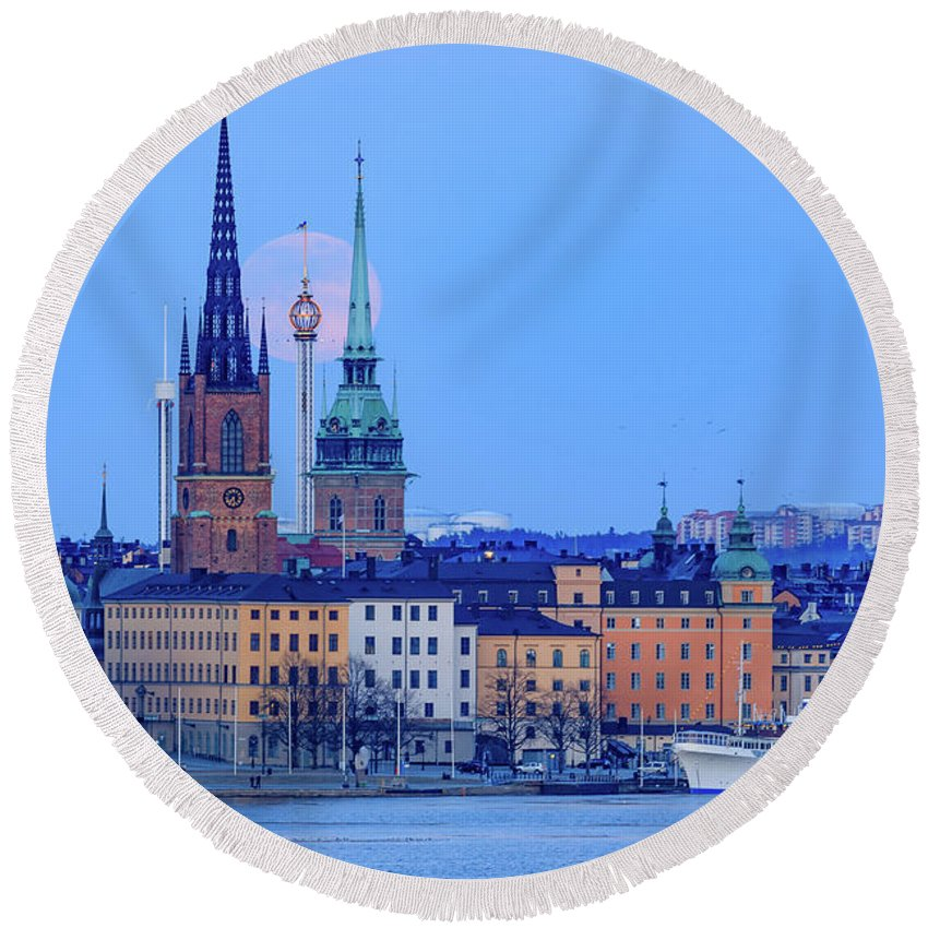 Full Moon Round Beach Towel featuring the photograph Lunar Teamwork Full Moon Rising Over Gamla Stan In Stockholm by Dejan Kostic