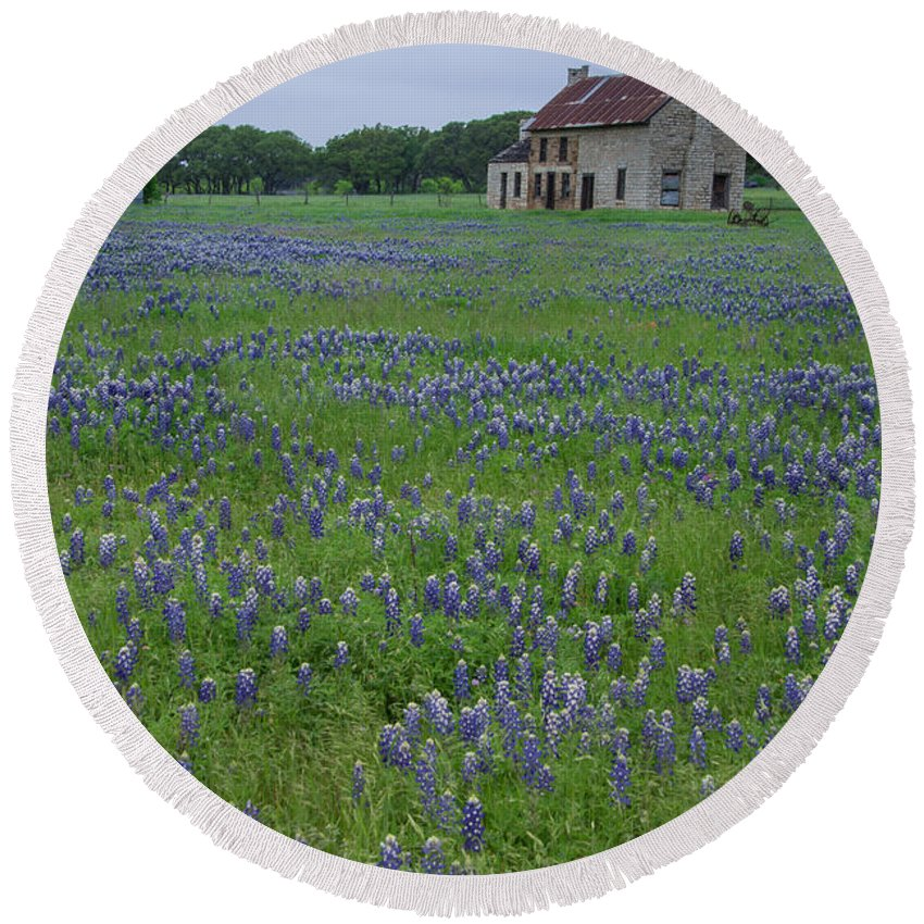 Marble Falls Round Beach Towel featuring the photograph Marble Falls Texas Stone House And Bluebonnets by JG Thompson