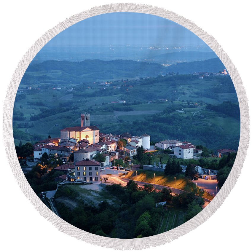 Smartno Round Beach Towel featuring the photograph Medieval Hilltop Village Of Smartno Brda Slovenia At Dusk With S by Reimar Gaertner