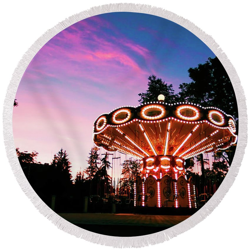 Sunset Round Beach Towel featuring the photograph Merry - Go - Round At Sunset by Diana Trutneva