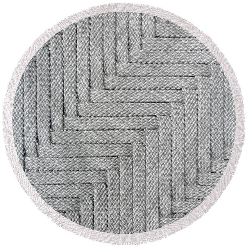 Metallic Round Beach Towel featuring the photograph Metallic Grey Rope Weaved Pattern by Yanin Kongurai