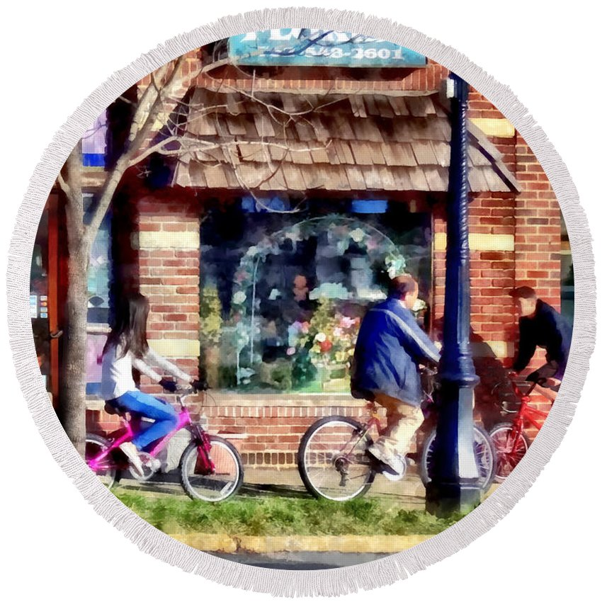 Metuchen Round Beach Towel featuring the photograph Metuchen Nj - Bicyclists On Main Street by Susan Savad