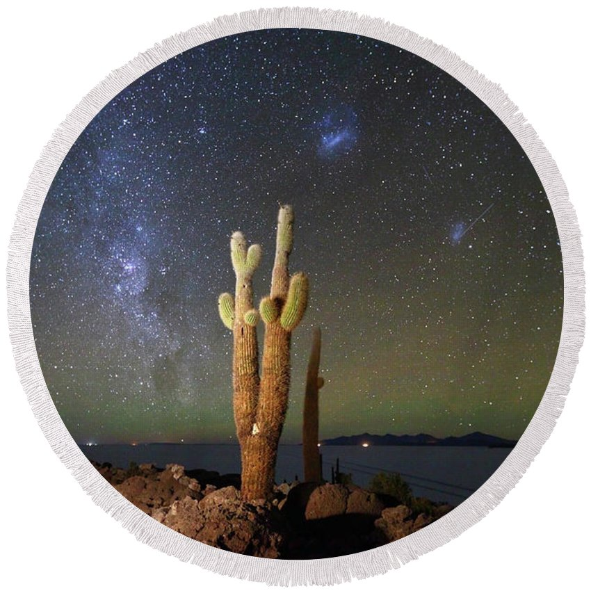 Astrophotography Round Beach Towel featuring the photograph Milky Way Magellanic Clouds And Giant Cactus Incahuasi Island Bolivia by James Brunker