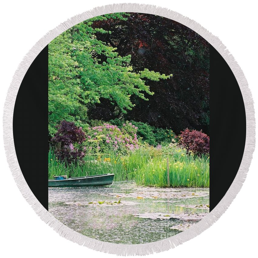 Monet Round Beach Towel featuring the photograph Monet's Garden Pond and Boat by Nadine Rippelmeyer