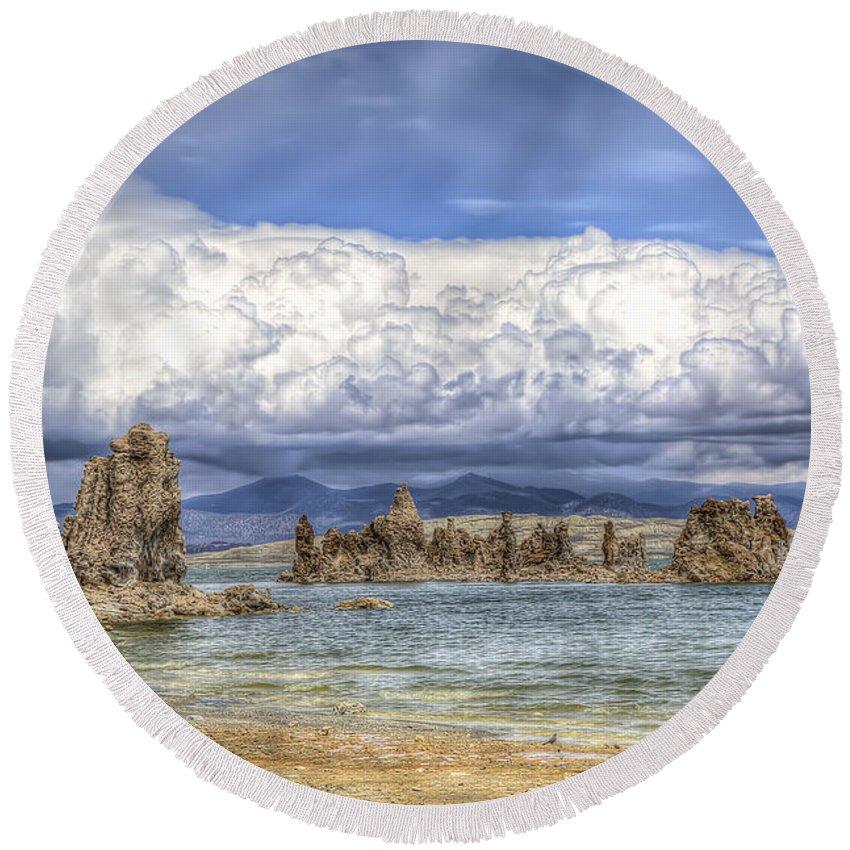 Mono Lake Round Beach Towel featuring the photograph Mono Lake Tufas And Clouds by Soroush Mostafanejad