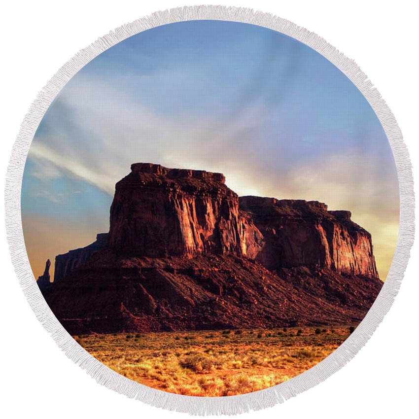 Monument Valley Round Beach Towel featuring the photograph Monument Valley sunset by Roy Nierdieck