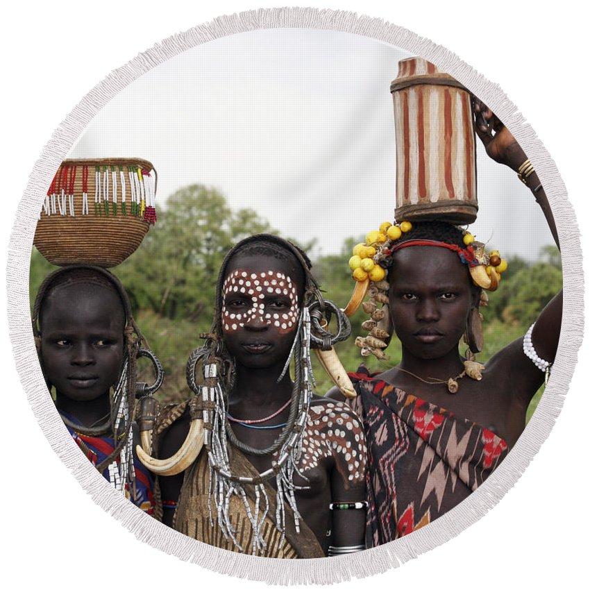 Ethiopia Round Beach Towel featuring the photograph Mursi Tribesmen In Ethiopia by Gilad Flesch