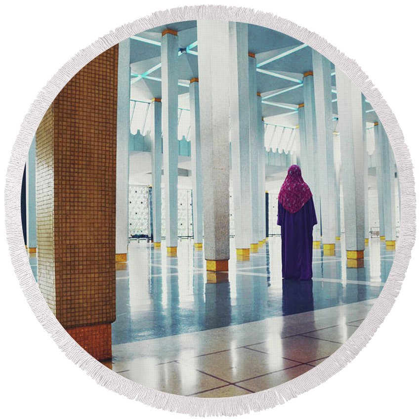 Allah Round Beach Towel featuring the photograph Muslim Woman Dressed In The Traditional Islam Clothing Standing Inside National Mosque In Malaysia by Srdjan Kirtic